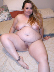 Leashed super fat milf spreading her legs and flashing her wet pussy.
