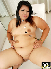Chunky asian gets naked and shows her fat pussy