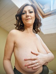 Very hot busty mature takes off her black dress and masturbates her nipples