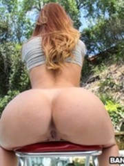 Busty ginger babe gets plugged outdoors from behind and blonde hottie in a red vest her booty cummed