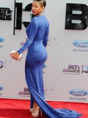 Braless babe meagan good posing on the red carpet in her blue low dress