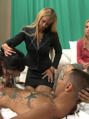 Tattoed guy doesn't mind his dick sucked and fucked by cum hungry hotties.