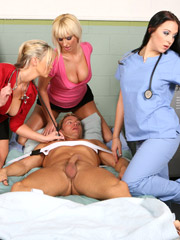 Tied up to the bed hospital patient is under humiliation of three crazy hotties.