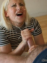 Horny blue-eyed blonde swallowing his big cock and gets a cum shot on her face.