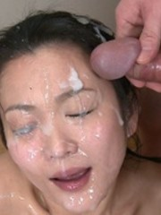 Saucy hoe gets sticky all over from a deluge of cum.