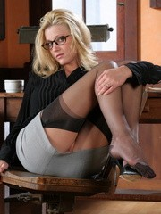 Sexy blonde carli taking off her office suit to stay in her sexy stockings and high heel at her workplace