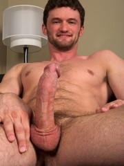 Brunette guy with a beard showing off his thick hairy cock