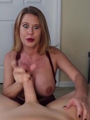 Horny bitch exposes tits and gets on knees to give cock explosive hand job