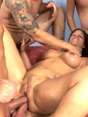 Big breast brunette milf and four horny guys in rough group sex action.