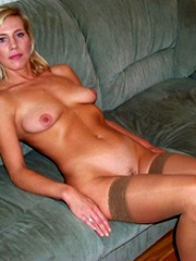Busty milf linda in tight stockings posing naked with hands tied.