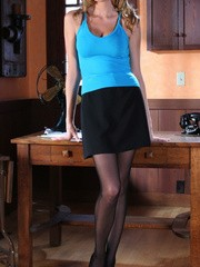Gorgeous blonde secretary in high heels demonstrating her shaved cooch through her transparent pantyhose