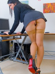 Super busty office girl in tan stockings slowly pulling down her tight panties.