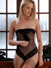 Small-titted blonde chick taking off her dress to wait for her boss in a black sexy body and stockings