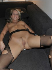 Busty blonde carina in sexy black stockings, black garter belt and high heeled boots. she lies on the wide bed exposing her perfect sexy bode.