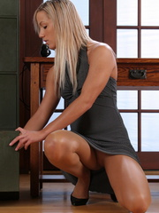 Hot secretary undresses in her boss' office and rubs her lustful slit