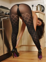 Gorgeous milf in pantyhose and skirt undresses completely in the kitchen