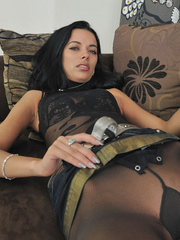 Dark haired sexy girl shalina spreads her legs in black pantyhose. she likes being watched.