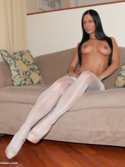 Very hot brunette babe bianca in white stockings and high heels on the sofa