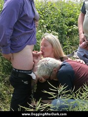 Busty blonde bitch in stockings serving orally three dudes outdoor