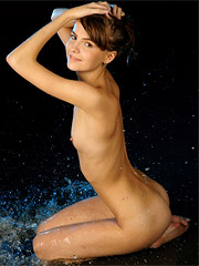 Martha confidently prance around, wet and naked.
