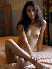 Tall dark haired model with great nipples and a big smile have great set in cabin.