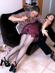 Shaved pussy brunette in sexy dress gets ass spanked on the chair. tags: sexy stockings, perfect butt, shaved vagina.