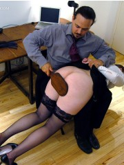 Hot secretary in glasses and stockings gets spanked right at her working place