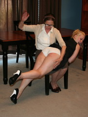 This horny blonde loves getting round ass spanked by her glasses wearing mother.