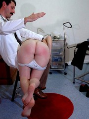 Curly blonde bitch in a white dress gets spanked badly with a various tools by dirty chick in black