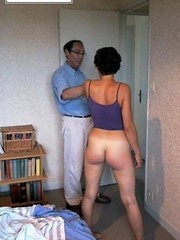 Horny black haired whore gets her tasty ass spanked by a horny guy.