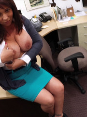 Big-titted brunette babe in an office suit gives a titjob and fucks with a horny guy in the office