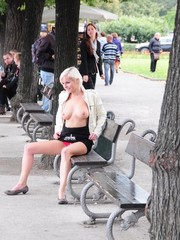 Horny blonde exposing her lusciously formed big boobs in public.
